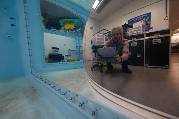 Keith Ellenbogen taking his first wireless underwater photo through the test tank