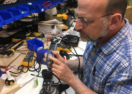 Dr. Tom Consi MIT Sea Grant's Engineering Educator is modifying a USB cable to fit within the underwater housing